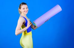Yoga class concept. Yoga as hobby and sport. Practicing yoga every day. Girl smiling slim fit athlete hold fitness mat. Fitness and stretching. Stretching stock image
