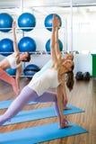 Yoga class in fitness studio Stock Image