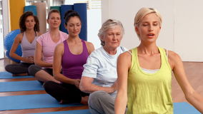 Yoga class in fitness studio stock footage