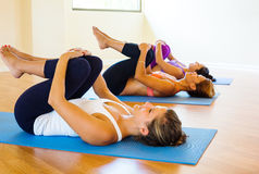 Yoga Class. Group of Young People Relaxing Practicing Yoga, Healthy Lifestyle Royalty Free Stock Image