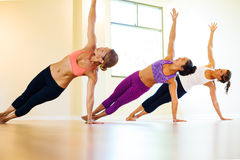 Yoga Class. Group of Young People Relaxing Practicing Yoga, Healthy Lifestyle Stock Photo