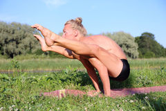 Yoga class outdoors Stock Photo