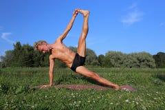 Yoga class outdoors Stock Image