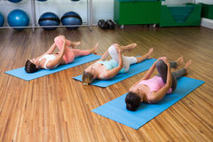 Yoga class stretching in fitness studio Stock Image