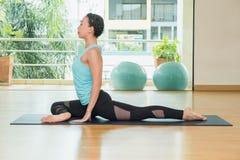 Yoga class studio,asian woman master doing Half Pigeon pose,Heal Stock Images