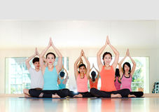 Yoga class in studio room,Group of people doing seated tree pose Stock Photography