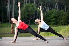 Yoga class: Utthita Parsvakonasana Pose Stock Images