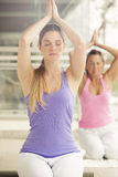 Yoga class. Women in gym class, relaxation exercise Stock Photo