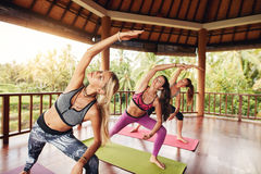 Yoga class with women stretching arms Stock Image