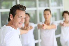 Yoga classes guided by a male yoga teacher Royalty Free Stock Photography
