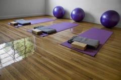 Yoga Classroom. Three purple mats on a yoga classroom Royalty Free Stock Photo