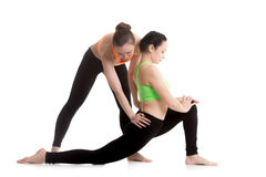 Yoga with coach, Ardha Hanumanasana (Half Monkey God Pose) Stock Photo