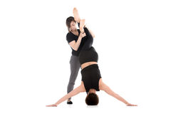 Yoga with coach, Iron Cross headstand Royalty Free Stock Image