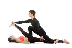 Yoga with coach Stock Photography
