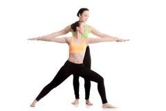 Yoga with coach, Virabhadrasana 2 Stock Images