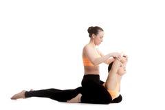 Yoga coaching, cobra pose royalty free stock images