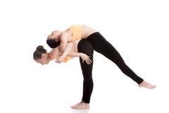 Yoga coaching, exercises for shoulders Stock Photo