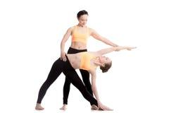 Yoga coaching, Trikonasana pose Stock Image