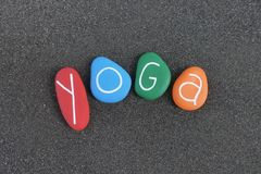 Yoga, colorful fitness concept with sea stones over black volcanic sand stock images