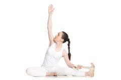 Yoga con los apoyos, Parivrtta Janu Sirsasana Fotografía de archivo libre de regalías