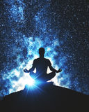 Yoga concept. Back view of meditating man on mountain top. Space background. Yoga concept Stock Photography