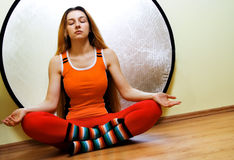 Yoga concept - woman relaxing in lotus position Stock Photography