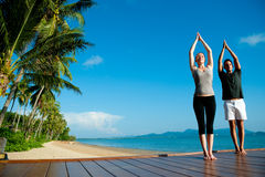 Yoga Couple By Ocean Stock Image