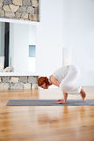 Yoga Crow Pose in wooden floor gym. And mirror indoor Royalty Free Stock Photo