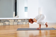 Yoga Crow Pose in wooden floor gym. And mirror indoor Royalty Free Stock Images