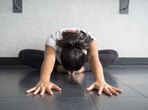 Yoga dancer Hip stretch in butterfly position reaching forward head to feet. With arms outstretched royalty free stock images
