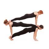 Yoga de groupe sur un fond blanc Photographie stock