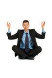 Yoga de la práctica del hombre de negocios Imágenes de archivo libres de regalías