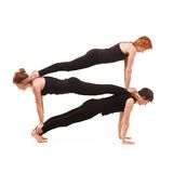 Yoga del gruppo su un fondo bianco Fotografia Stock