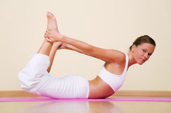 Yoga - Dhanurasana Royalty Free Stock Photo