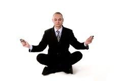 Yoga di affari con i telefoni mobili Fotografia Stock