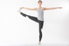 Yoga di esercizio della giovane donna Fotografia Stock