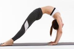 Yoga di esercizio della giovane donna Fotografie Stock Libere da Diritti