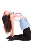 Yoga di pilatos della ragazza isolata sull'esercizio bianco di sport del fondo Fotografia Stock