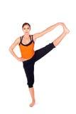 Yoga di pratica della giovane donna attraente di misura Immagine Stock