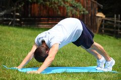 Yoga - Downward Facing Dog Position stock photo