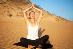 Yoga at the dunes Stock Photo