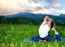 Yoga Eka Pada Rajakapotasana pose in mountains Royalty Free Stock Photo