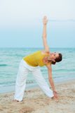 Yoga on the evening beach. Stock Photography