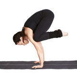 Yoga excercising bakasana Royalty Free Stock Photos