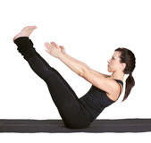 Yoga excercising navasana Stock Photo