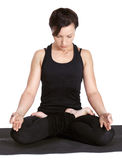 Yoga excercising Padmasana Royalty Free Stock Photography