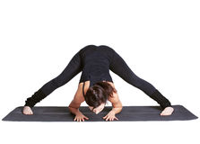 Yoga excercising prasarita padottanasana Royalty Free Stock Photography