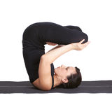 Yoga excercising urdhva padmasana Royalty Free Stock Photo