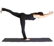 Yoga excercising Virabhadrasana III Stock Photos