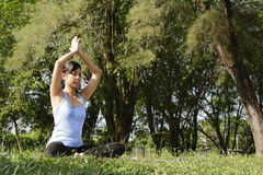 Yoga Exercise. An Asian woman doing some yoga exercise at a  forest Royalty Free Stock Photos